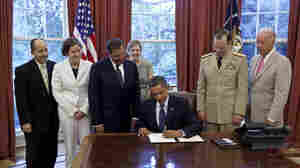 President Barack Obama signs the certification stating that the statutory requirements for repeal of DADT have been met, in the Oval Office, July 22, 2011.