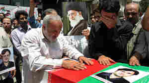 Relatives and friends mourn over the coffin of Darioush Rezai-Nejad in Tehran, Iran. Rezai-Nejad was killed in a deadly shooting on Saturday. Iran said he was a university student — not a nuclear physicist.