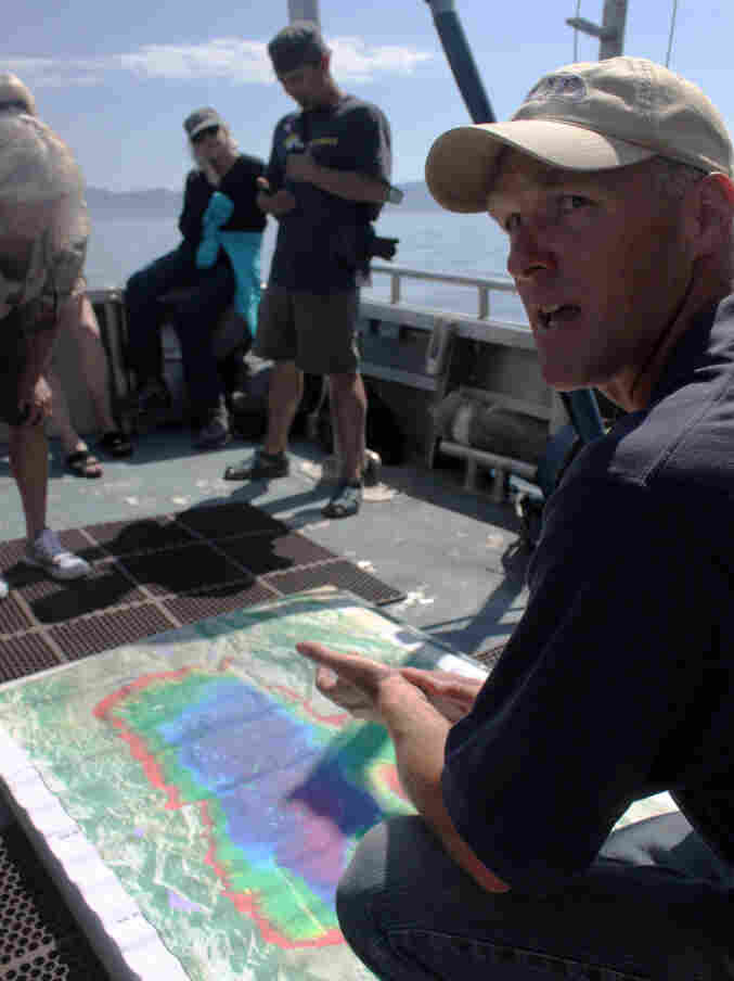 Researcher Brant Allen of UC-Davis explains features of Lake Tahoe to a group of passengers on board a research vessel.