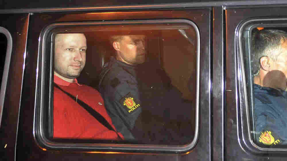 Anders Behring Breivik (left) exited an Oslo courthouse in an armored police vehicle following a hearing Monday at which he pleaded not guilty to one of the deadliest modern mass killings in peacetime.