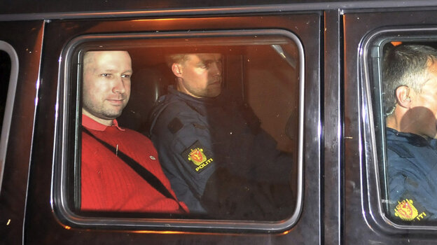 Anders Behring Breivik (left) exited an Oslo courthouse in an armored police vehicle following a hearing Monday at which he pleaded not guilty to one of the deadliest modern mass killings