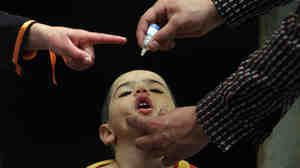 An Afghan health worker administers the polio vaccine to a child during a vaccination campaign in Kabul, Afghanistan, in 2010.