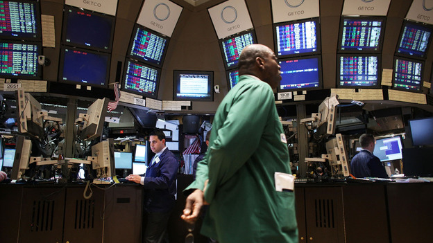 Traders work on the floor of the New York Stock Exchange in April. The country's credit rating could suffer if Congress fails to address the nation's long-term debt. (Getty Images)