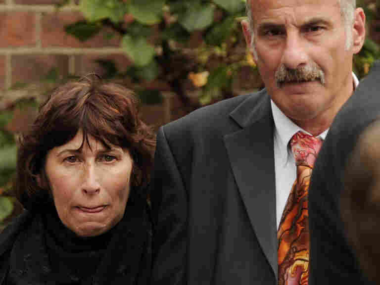 Janis, (L) mother of late British singer Amy Winehouse, leaves after a cremation ceremony for her daughter in north London, on July 26, 2011.