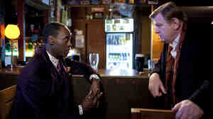 Cop And A Laugh: Sgt. Gerry Boyle (Brendan Gleeson, right) finds his routine indulgences challenged by the presence of straight-laced FBI Agent Wendell Everett (Don Cheadle) in his small Irish patrol. The pair must work together to track down a trio of dope smugglers.