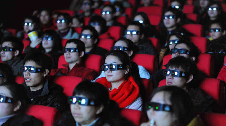 Chinese moviegoers wear 3-D glasses as they watch Avatar in January 2010.