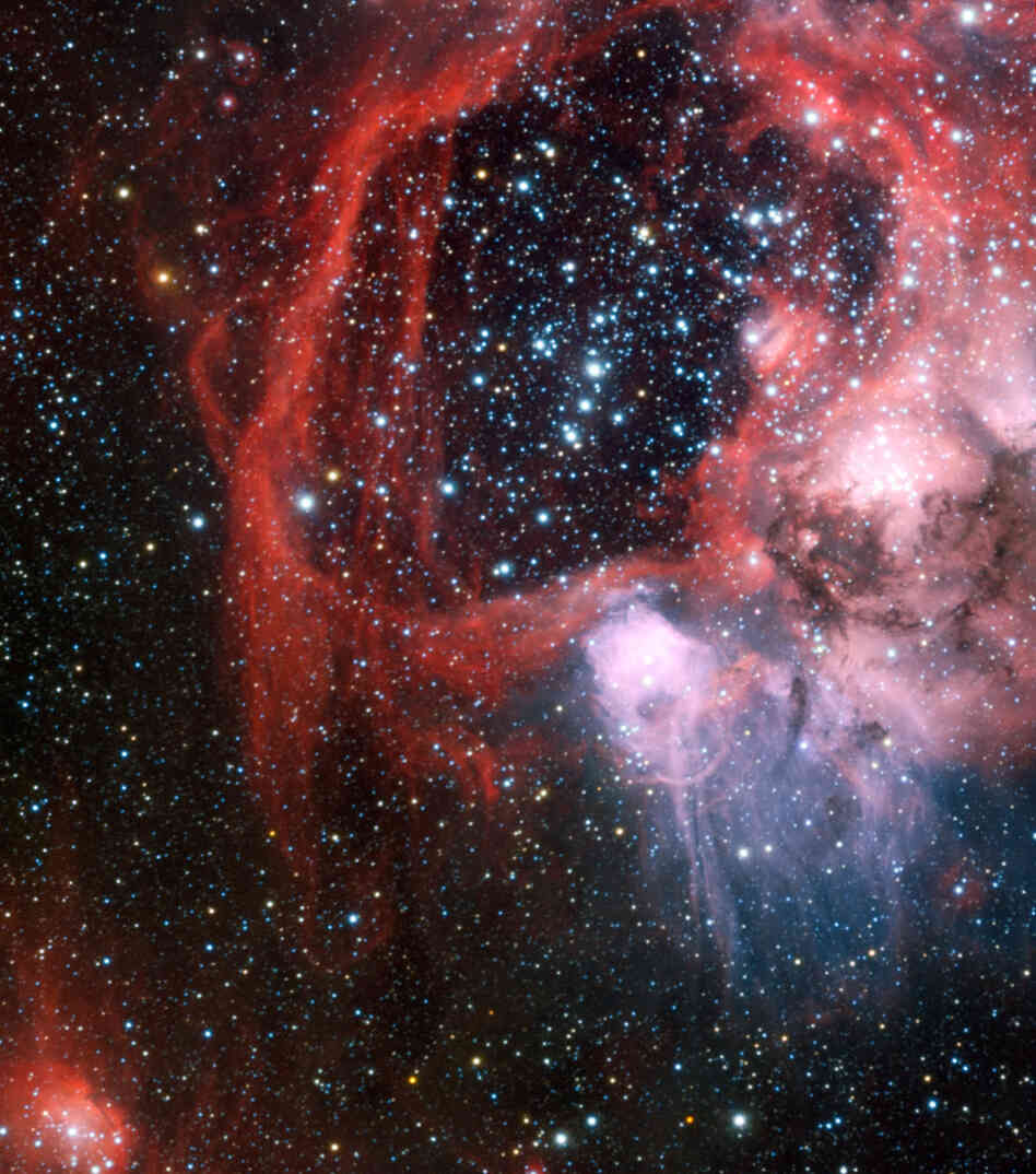 The European Southern Observatory's Very Large Telescope in Chile captured this striking view of the nebula around the star cluster NGC 1929 within the Large Magellanic Cloud, a satellite galaxy of our own Milky Way separated by a mere 179,000 light years.