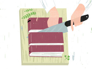 A chef cuts up a book.