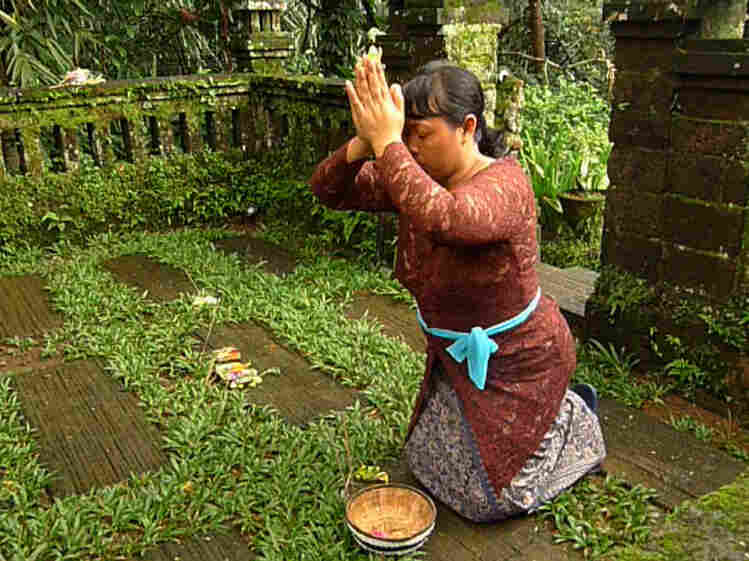 Gusti Kompiang Sari, an Indonesian maid, blesses a house in Bali, Indonesia. Viewers are rarely given so much context in the film.