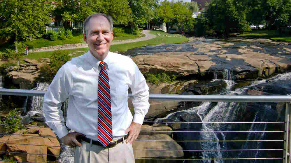 """Mayor Knox White has led Greenville, S.C., for 15 years, and is running unopposed for another term. Here, he stands near a natural waterfall that's in the middle of the city's downtown, in a park that cost $13 million. """"Within two years,"""" he says, """"over $100 million in private investment was created around the park."""""""
