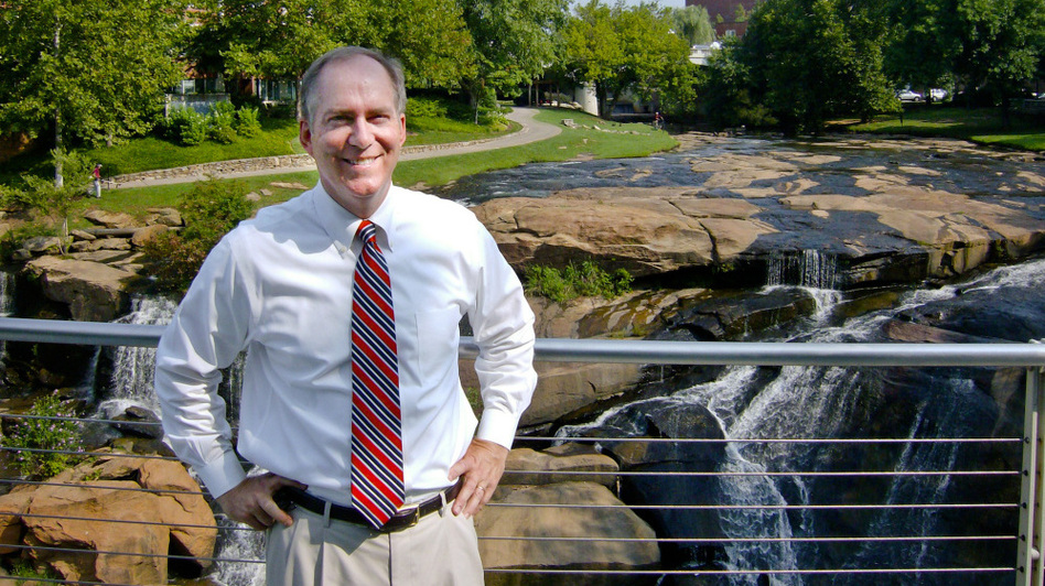 "Mayor Knox White has led Greenville, S.C., for 15 years, and is running unopposed for another term. Here, he stands near a natural waterfall that's in the middle of the city's downtown, in a park that cost $13 million. ""Within two years,"" he says, ""over $100 million in private investment was created around the park."""