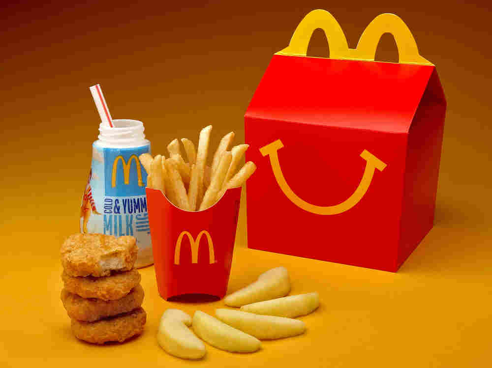 McDonald's cutting down on french fries and adding more healthful items, such as apple slices, to Happy Meals.