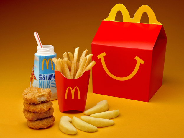 McDonald's cutting down on french fries and adding more healthful items, such as apple slices, to Happy Meals. (McDonald's)