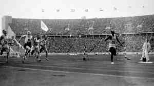 Jesse Owens crosses the finish line in Berlin to win the 100-meter sprint, one of four events in which Owens won gold medals at the 1936 Olympics.