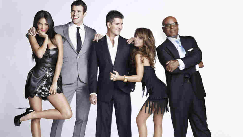 Steve Jones (second from left) and judges Nicole Scherzinger, Simon Cowell, Paula Abdul, and L.A. Reid are heading up Fox's The X Factor, which will premiere this fall.