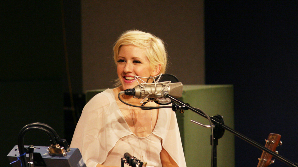 Ellie Goulding listens to host Michel Martin's remarks at NPR headquarters in Washington D.C., on July 25. (NPR )