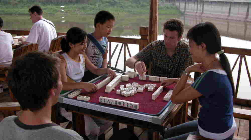 Michael Levy enjoys a game of Mahjiang with local youth.