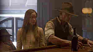 Olivia Wilde stars as an elusive traveler, and Daniel Craig plays a stranger with no memory of his past in the sci-fi Western Cowboys & Aliens.