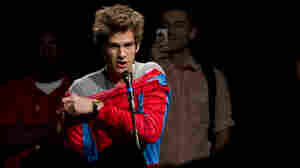 Actor Andrew Garfield asks a question from the audience wearing a Spider-Man costume  during the Sony panel presentation of The Amazing Spider-Man at Comic Con last Friday.