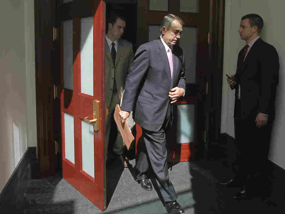 House Speaker  John Boehner of Ohio emerges from a closed-door caucus with House Republicans, July 27, 2011.