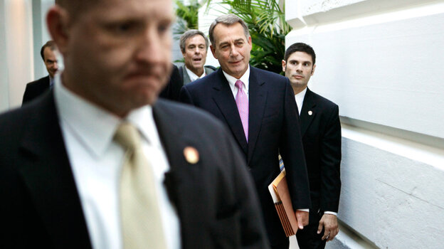 House Speaker John Boehner (R-OH), surrounded by plainclothes police officers, arrived at the Capitol for a House GOP caucus meeting Wednesday.
