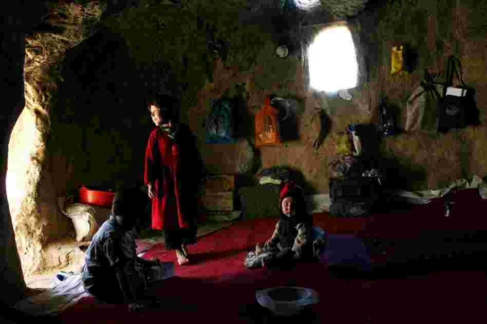 Afghan children living in a small cave near the destroyed Buddha statues, in 2006. Homeless people in the area sometimes move into the caves. They say that new homes are more important than restoring the Buddhas.