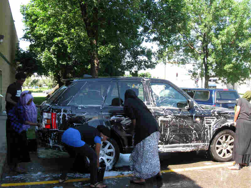 College students work at a charity car wash set up to benefit the victims of Somalia's drought.