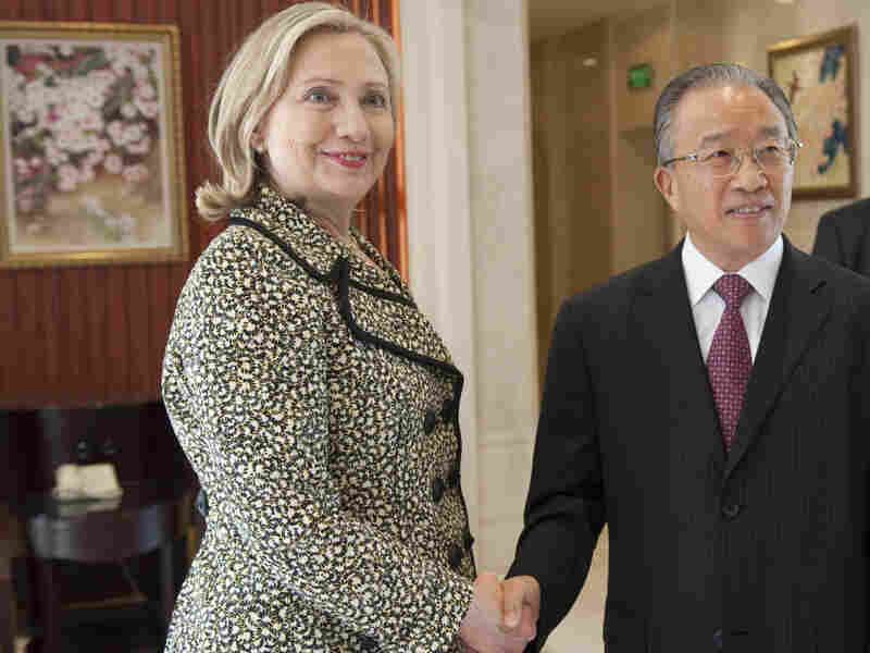 Senior Chinese official Dai Bingguo and U.S. Secretary of State Hillary Clinton shake hands before their meetings in Shenzhen, China, on Monday.