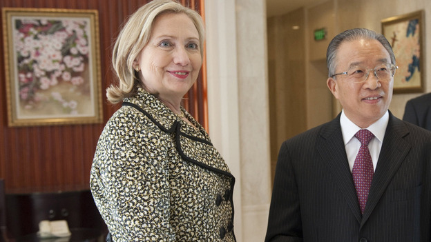 Senior Chinese official Dai Bingguo and U.S. Secretary of State Hillary Clinton shake hands before their meetings in Shenzhen, China, on Monday. (AP)