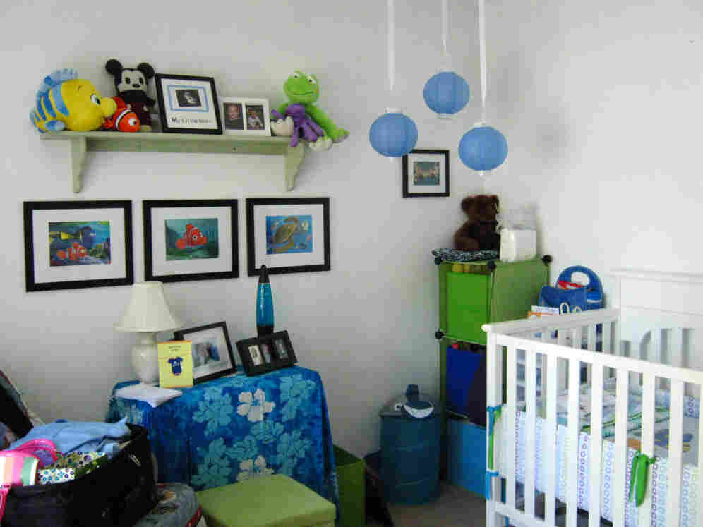 "Lucy and Aaron Peck decorated Dexter's room with an aquarium theme. They are planning to hang handmade ""fish"" on the wall above the crib."