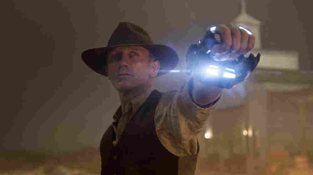 Bluest Hand In The West: Daniel Craig is the strong, silent type in Cowboys & Aliens, playing an mysterious outsider with a connection to the space invaders who have descended on the film's mining town. But his classic Western antihero can't defeat the film's cold, rote special effects.