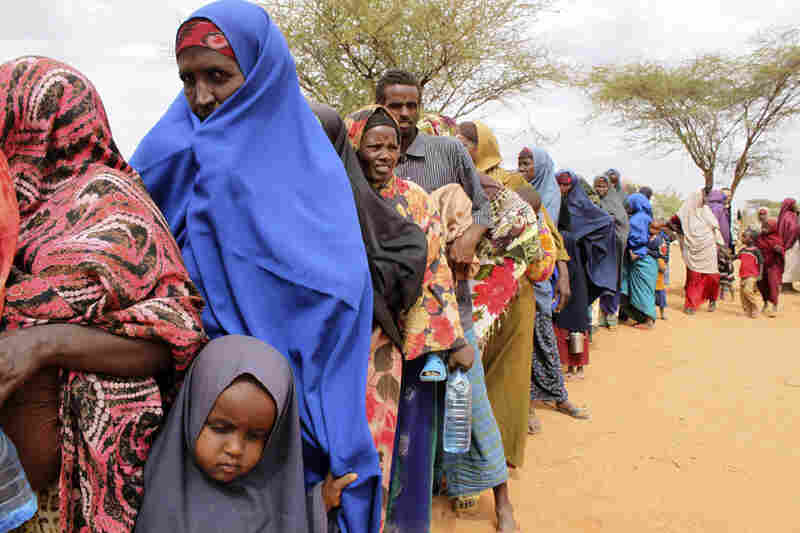 Women line up to sign up for World Food Program emergency distributions in Dolo, Somalia, on July 24. World Food Program executive director Josette Sheeran has estimated 2.2 million Somalis are in desperate need of aid.