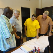 Daphne Wilson (center) and her engineering team review plans for a project at Mitchell International Airport in Milwaukee, Wis.