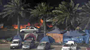 Tents burn on March 16 as Bahraini security troops raid the site of a pro-democracy sit-in at Pearl Square, in the capital, Manama.