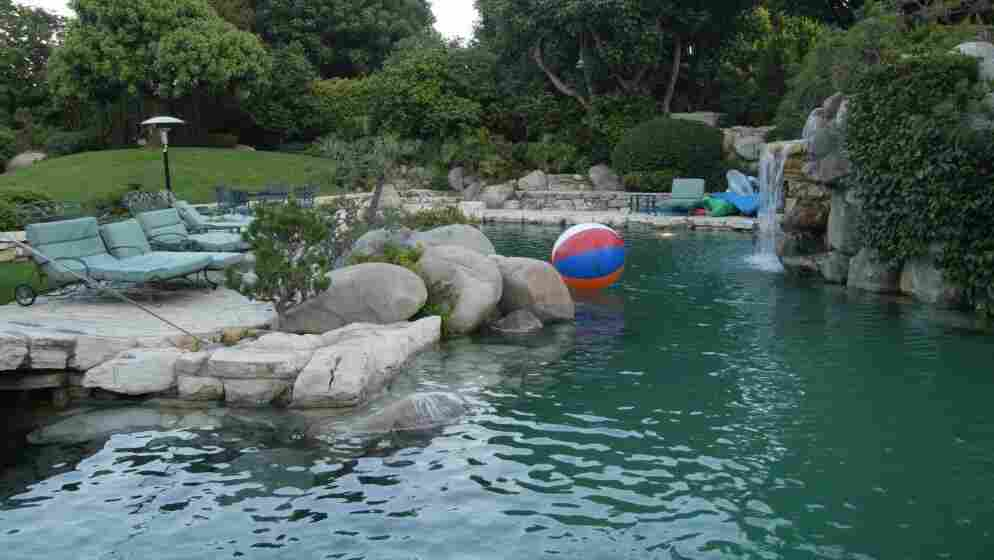 This shot of the Playboy Mansion pool and the outside of the grotto was taken in 2002. It looks very much the same now.