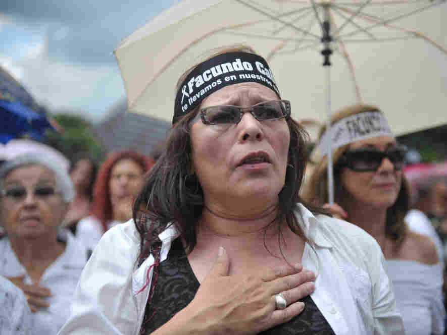 Guatemalans march for peace after the murder of  Facundo Cabral, an Argentine singer/ songwriter shot dead in a confused incident, in Guatemala City, on July 10, 2011.