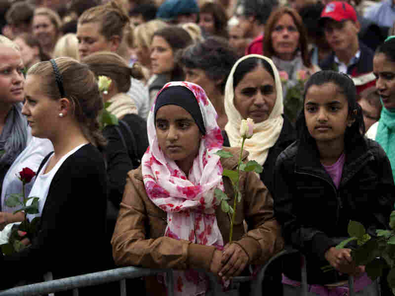 "People gather outside Oslo City Hall on Monday to participate in a ""rose march"" in memory of the victims of Friday's twin attacks in Norway. Anders Behring Breivik, who admitted to the attacks but entered a plea of not guilty, said he wanted to save Europe from Muslim immigration."