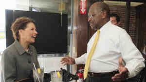 Presidential hopefuls Rep. Michele Bachmann (R-MN), who signed a pledge against abortion rights, and businessman Herman Cain, who has not, seen at the taping of a radio show in New Hampshire in May.