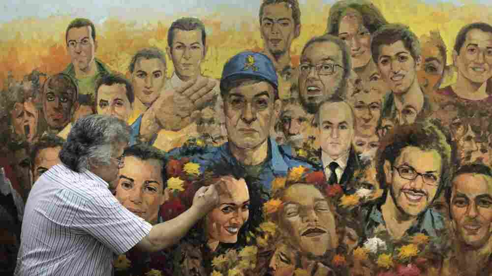 "Egyptian artist Taha el Korany finished a painting showing a military officer saluting the ""martyrs"" of Egypt's revolution at his studio this week — a day after an Egyptian court decided to combine the trials of the former interior minister and ousted President Hosni Mubarak."