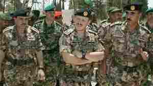 King Abdullah II of Jordan visits the Royal Military College in Guy Cramer's camouflage.