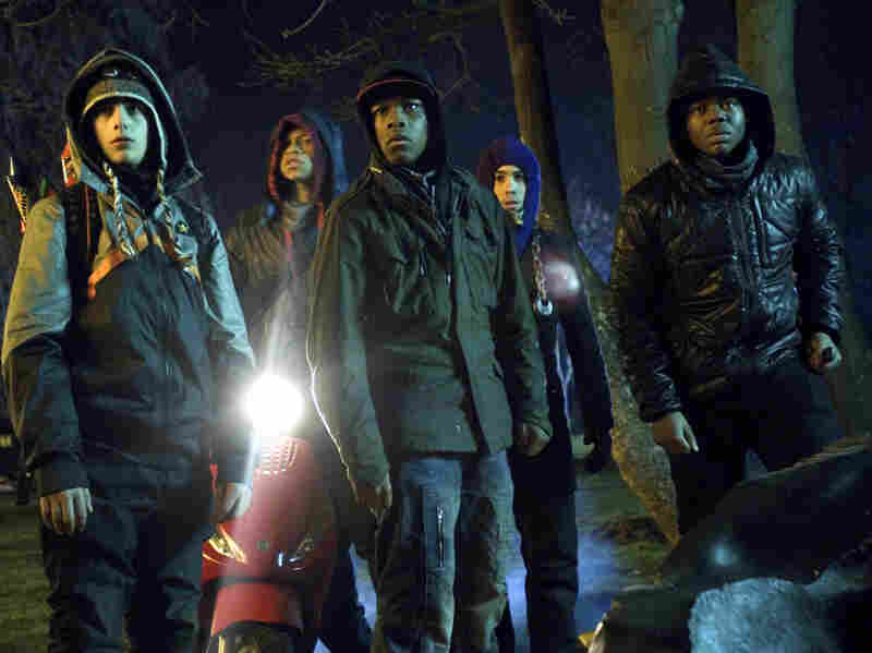 From left to right, Alex Esmail, Franz Drameh, John Boyega, Simon Howard and Leeon Jones star in the low-budget British sci-fi film Attack the Block.