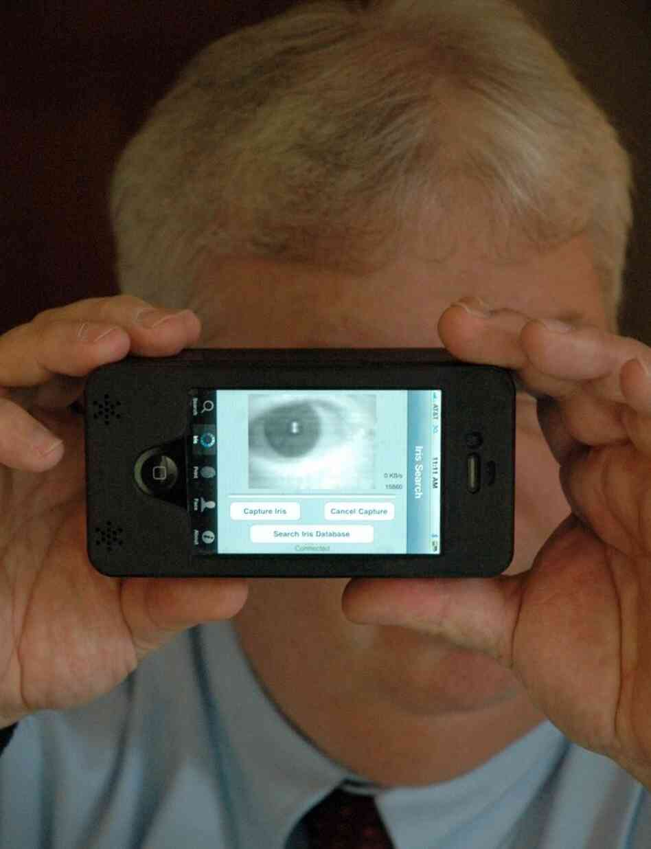 Sean Mullin, CEO of BI2 Technologies, scans his own eye with the MORIS, or