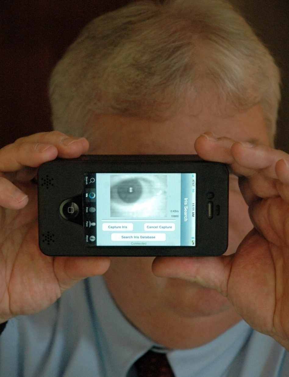 Sean Mullin, CEO of BI2 Technologies, scans his own eye with the MORIS, or Mobile Offender Recognition and Information System. The device attaches to an iPhone and allows police in the field to scan a person's iris, face or fingerprint and then check it against a database to verify his or her identity.
