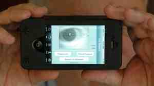 Sean Mullin, CEO of BI2 Technologies, scans his own eye with the MORIS, or Mobile Offender Recognition and Information System. The device attaches to an iPhone a