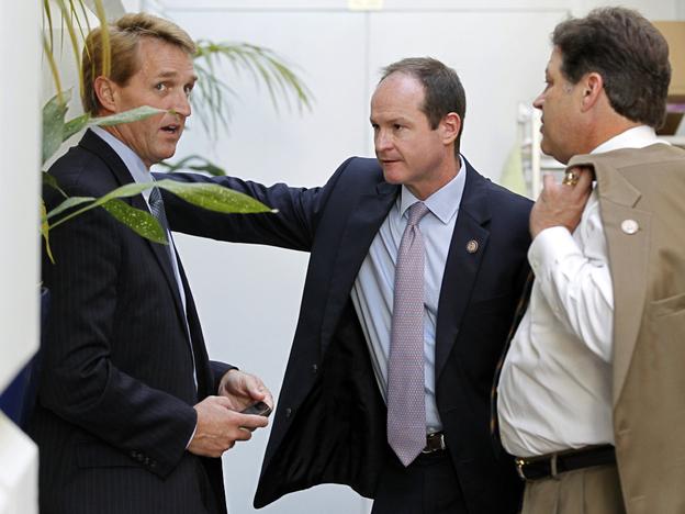 "Republican congressmen Jeff Flake of Arizona, (l) a publicly announced ""no"" vote; John Sullivan of Oklahoma (c), and Bill Shuster of Pennsylvania, Wednesday, July 27, 2011. (AP)"