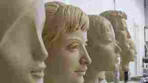 These sculpted clay heads reflect the variety of  realistic and abstract designs in today's mannequins.