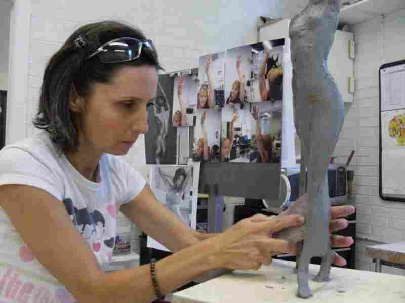 Fusion Specialties Sculptor Ileana Barbu carves a two-foot clay sculpture — one of the first stages in creating a custom mannequin prototype.