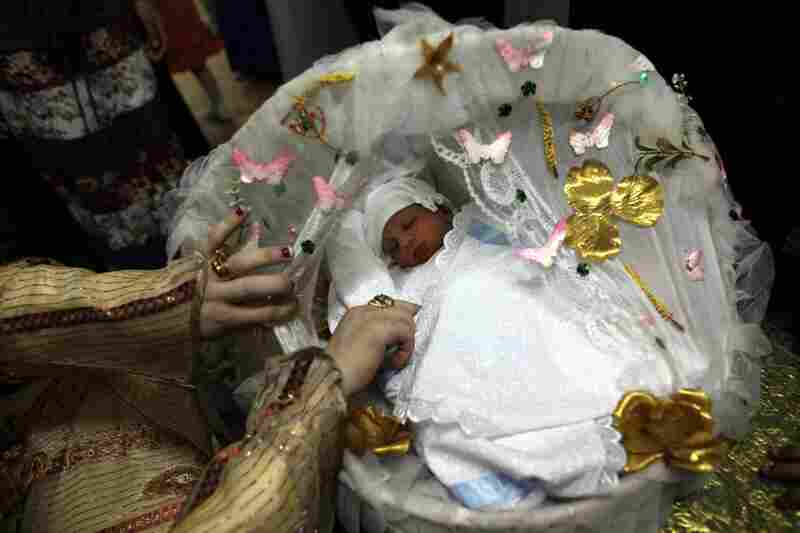 Baby Hamza slept through the entire Sebou. Family members gather for the ceremony to celebrate the baby's, and the mother's, survival of childbirth; to introduce and officially name the child; to ward off evil spirits; and to instill health, strength and obedience in the baby.