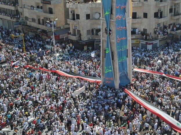 In a photo provided to AFP by a third party, Syrians demonstrate against the government after Friday prayers in Hama on July 29. The Syrian government has banned most foreign media from entering the country, making it difficult to independently confirm events.