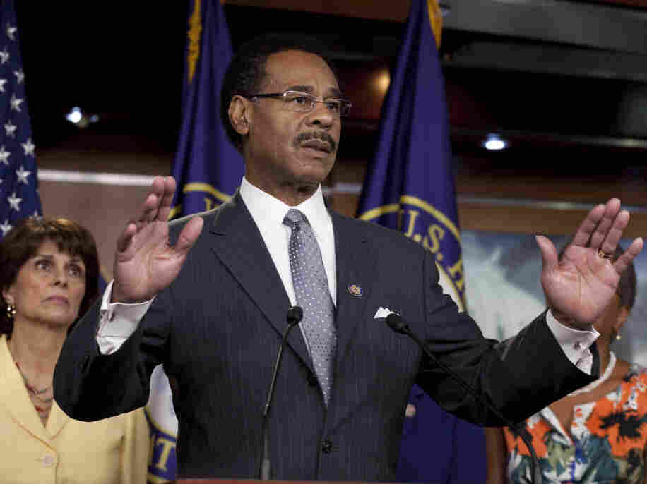 Rep. Emanuel Cleaver, D-Mo., leader of the Congressional Black Caucus, speaking on Capitol Hill in Washington on Wednesday, July 20, 2011. Rep. Lucille Roybal-Allard, D-Calif., listens at left.